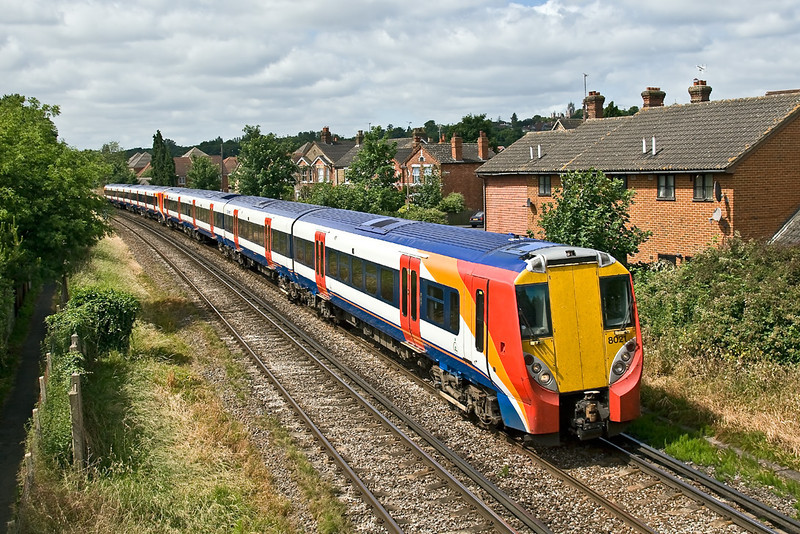 26th Jun 08: Without  SWT branding above the windows 458021 leads 023 on a Reading to Waterloo service through Egham