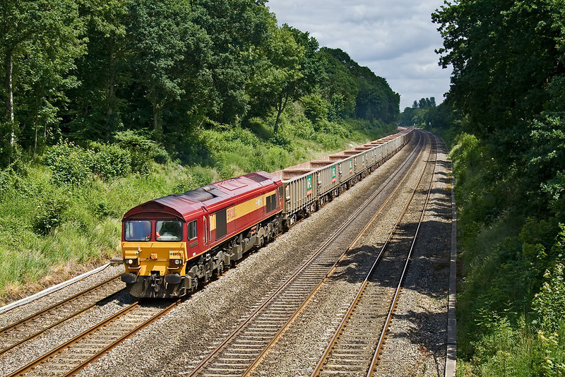 13th Jun 08:  59202 is tasked with the Acton to Merehead stone empties pictured here from he Duffield Road bridge in the Sonning Cutting