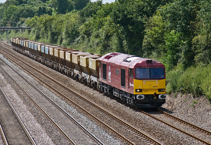 25th Jun 08:  Newly re-branded 60040 'Territorial Army Centenary' works the 12.40 Appleford to West Drayton PGAs east through Shottesbrooke.