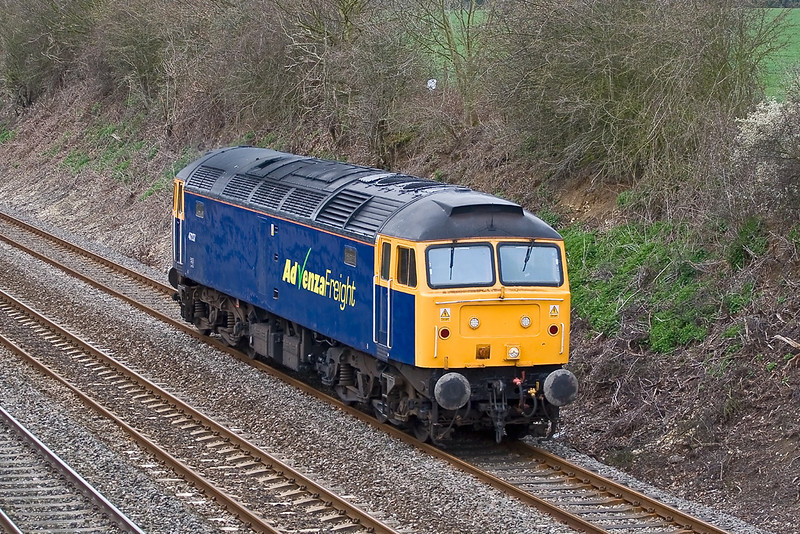 25th Mar 08:  Advensa's 47237 trundles along the relief at Shottesbrooke