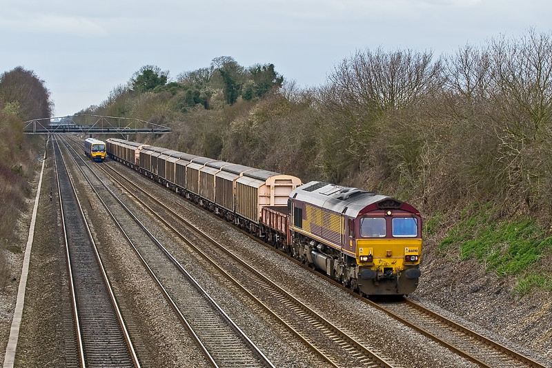 25th Mar 08:  With barriers in the consist it is probably carrying explosives! 6M96 MoD service from Didcot to Wembley and 66090.  The train originates from Kineton and will go to Shoeburyness,