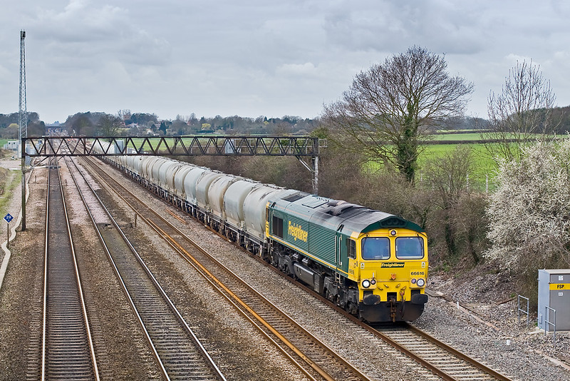 18th Mar 08:  The late running Theale to Earls empty cement tanks at Milley Bridge powered by 66616