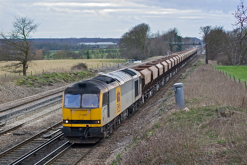 6th Mar 08:  With Tug 77 rostered for 6M57 the 14.00 Wool to Watford sand, now routed via tha SWML, it was worth going out in the rapidly failing light on a very dull day.  Seen here on the short rise between Hook and Winchfield.  1/640 @ f2.8, ISO 800.
