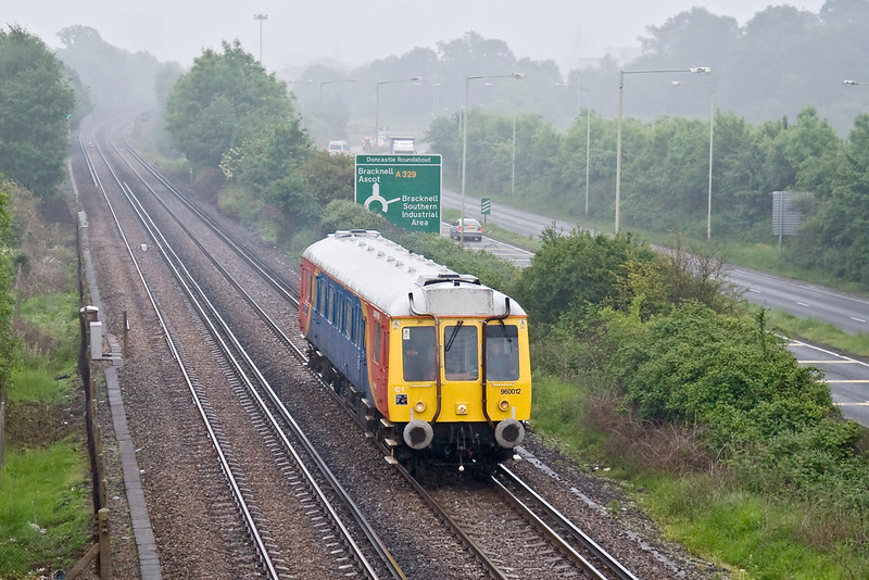 28th May 08: With heavy drizzle obscuring the view South West Trains Bubble Car 960012 leaves Bracknell for Reading. Shot settings were, Canon 30D, Canon 24-105 f4L. 1/640 @ f4, ISO 400.