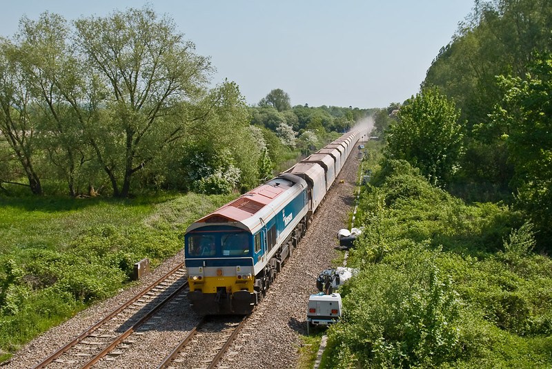 13th May 08:  With dust obscuring the station 59101 and the late running 7C31 Theale to Merehead leaves Kintbury