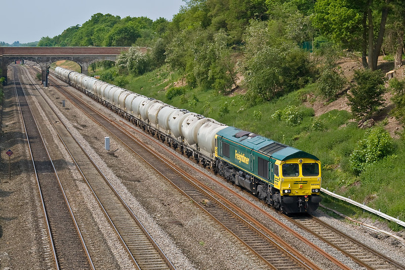 14th May 08:  The returning cement empties from Theale to Earles with 66596 on the point
