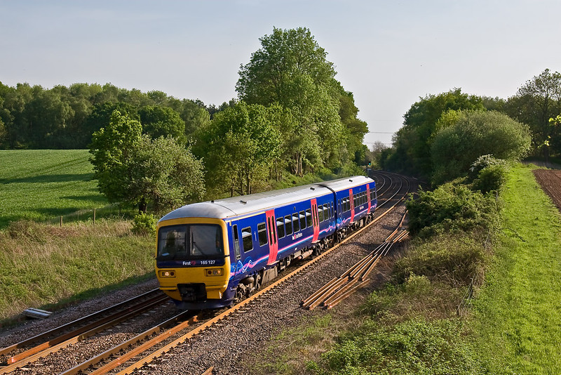10th May 08:  On a beautiful evening 165127 catches the light as it climbs through Silchester