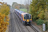 6th Nov 08: Echoing the Autumn colours on a very dull and dank day is 450543. Here crossing Addlestone Moor on 2S34 the 12.03 from Weybridge to Waterloo