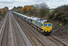 20th Nov 08:  Heavy Haul 66608 brings the Burngullow to Bow Olympic eastwards