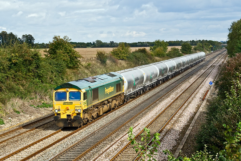 2nd Oct 08:  66608 trundles east through Shottesbrooke with a short rake of loaded Lafarge JPA's for Theale