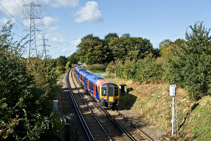 21st Oct 08:  Next stop 'Chertsey' for 450549 passing Watery Lane in Lyne.  With the M25 only 100 metres away this is anything but a quiet location.