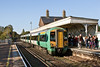 29th Oct 08: It is half term and the platform  at Angmering is crowded with youngsters as 377306 slows with a train to Brighton