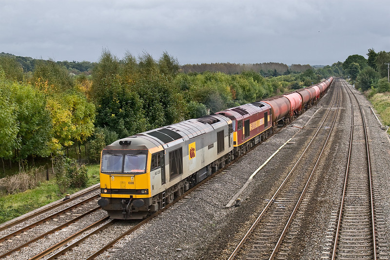 30th Sept 08:  60028 'John Flamsteed' was sent from Margam to recue a failed 60024 and 6B33 Theale to Robeston Murco empties.  The sky has brightened a little, but not for long.  My thanks to Pete Ball and Graham Lee for the info.