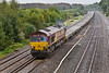 30th Sep 08:  A long load of nothing for 66116 on  the Marchwood to Didcot MoD stores service.  It's raining!