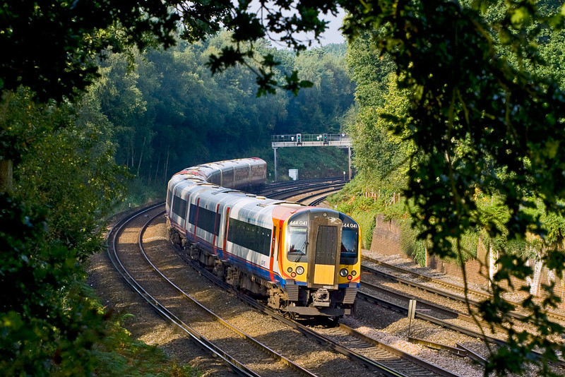 14th Sep 08:  444041 tails the 08.54 (1W19) to Bournemouth round the curve at Pirbright
