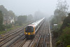 26th Sep 08:  Out of the mist comes 444019 the 08.05 Waterloo to Weymouth (1W17)