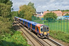 6th Sept 08:  High Capacity Desiro 450563 leads 450570 away from Vriginia Water
