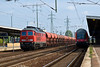 11th Sep 08: Diesil 233 702-0 with another massive rake of hoppers as a Dessau Nauen express waits the right away.