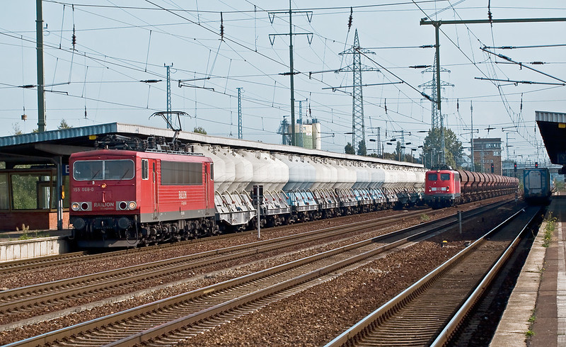 11th Sep 08: 155 068-0 with a train of cement wagons passes the hopper train