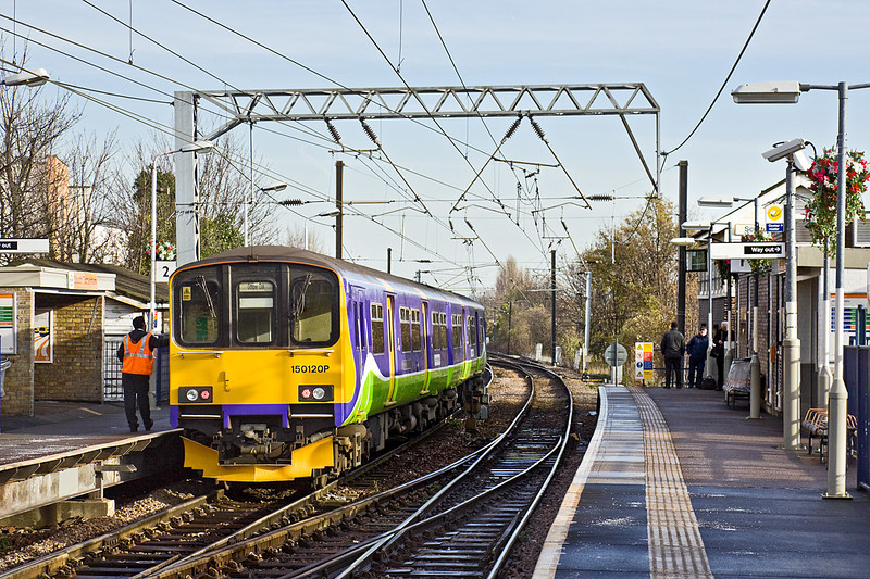 1st Dec 09:  The 11.25 from Gospel Oak to Barking stands at South Tottenham. 150120  was stuck there at the previous service had failed at Walthamstow