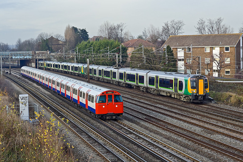 1st Dec 09:  The 12.53 from Birmingham New Strreet to Euston 2Y10 and Underground Bakerloo Service 203to Elephhant & Castle are side by side approaching South Kenton.