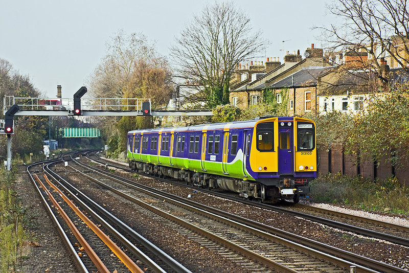 1st Dec 09:  313103 forming 2Y29 arrives at Kensington Olympia having left Willesden Junction at 13.38 for the trip to Clapham Junction