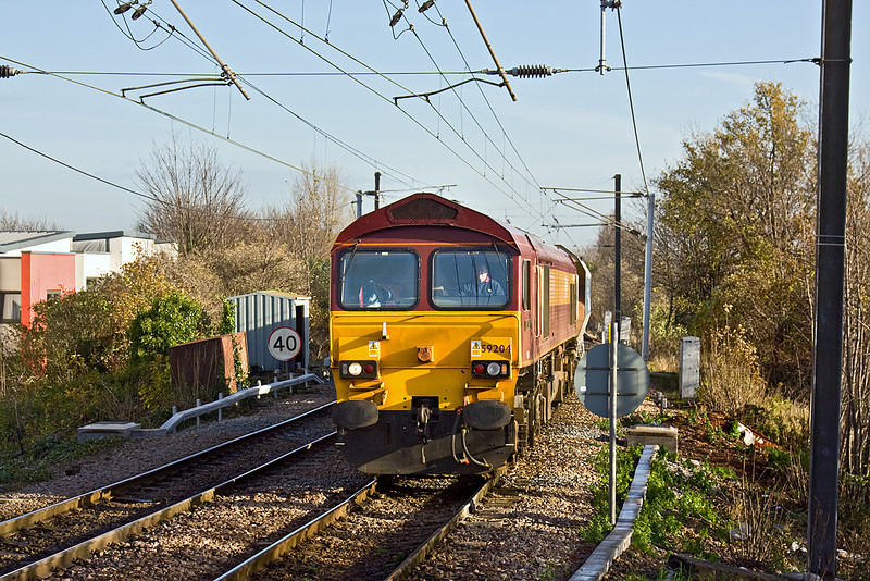 1st Dec 09:  Entering South Tottenham is 59204 working 6V28 empty hoppers from Daggenham to Acton Yard