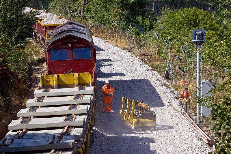 23rd Aug 09:  An engineer uses the Remoteley controlled ballast compactor.  At this point it is being turned to run away from the camera