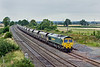 20th Aug 09:  66546 plods along the loop with coal empties from Drax to Daw Mill at Elford