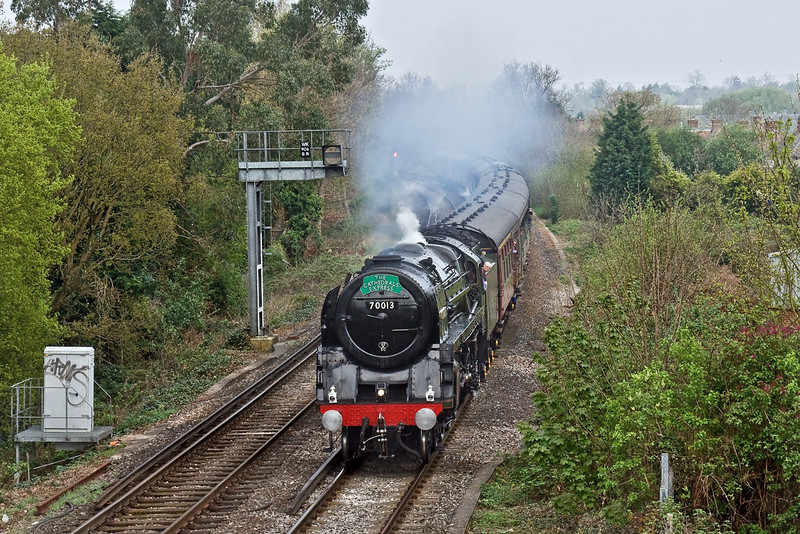 13th Apr 09:  70013 'Oliver Cromwell' at Cox's Lock in Addlestone working  The Cathedrals Express  from Victoria to Yeovil via the Pompey Direct line.