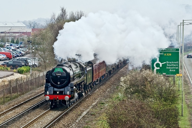 2nd Apr 09:  3 minutes prior to the clouds clearing away BR Standard 4-6-0 70013 'Oliver Cromwell' passes Amen Corner in Bracknell with The Cathedrals Express from Victoria to Bristol
