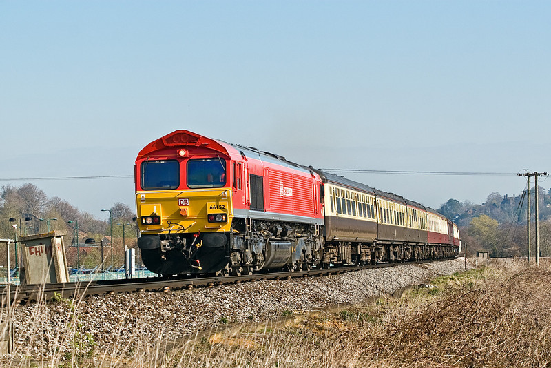 1st Apr 09:  The 'Purbeck Pioneer' tour from Victoria to Swanage, top 'n tailed by 66152 & 66142, was to comemorate the opening of the main line connection at Worgret Junction. Captured here in perfect light as it nears the site of Peasmarsh Junction