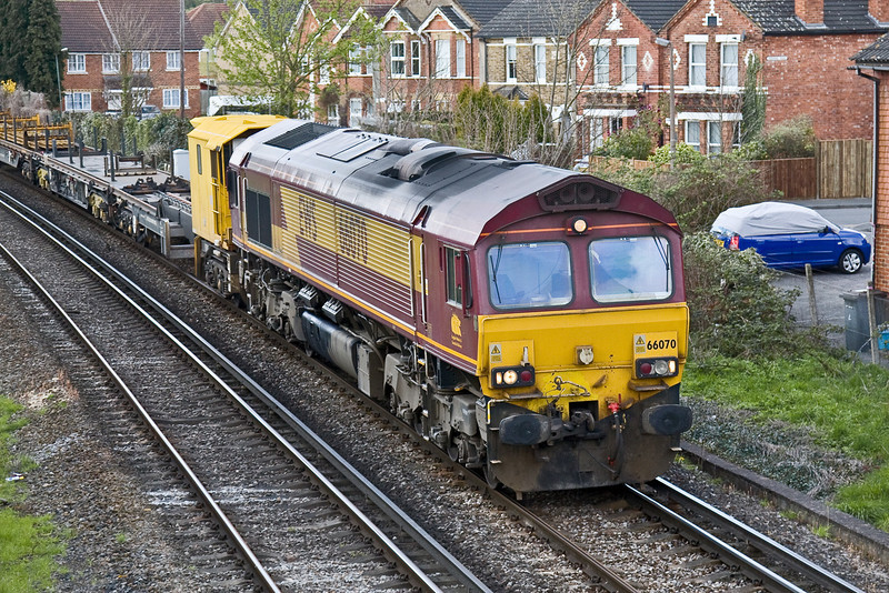 7th Apr 09:  66070 works 6Y41  Departmental from Eastleigh to Hoo Junction through Egham.  A very bright sky and background and a big cloud overhead forced a change of plan and a loco only shot.