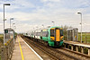 16th Apr 09:  2D25 the 11.52 Brighton to Ore in the hands of 377103 draws into Normans Bay Station,