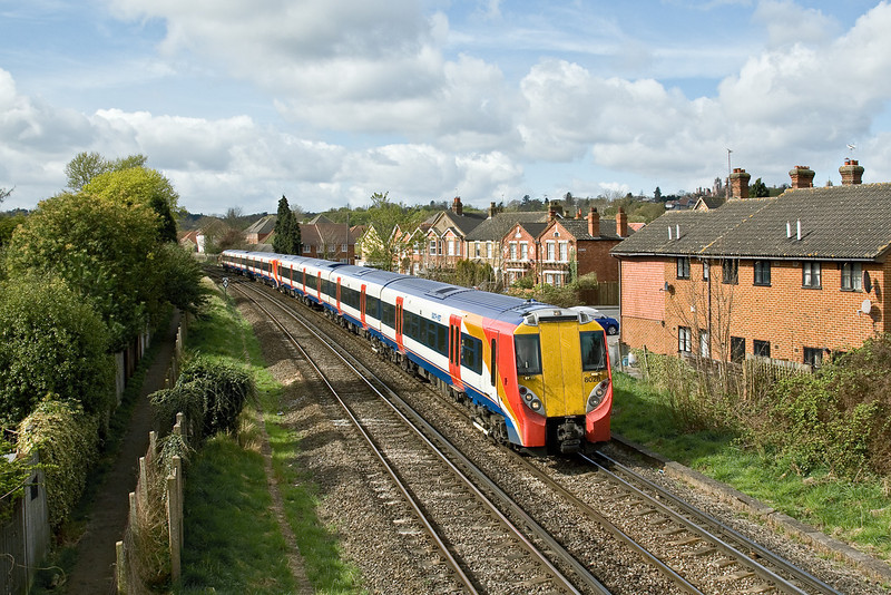 7th Apr 09:  The 09.42 from Reading to Waterloo fronted by 458028 slows for the Egham stop. 458015 is the trailing set