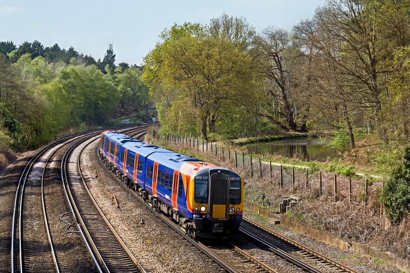 21st Apr 09: Leaving Portsmouth Harbour at 11.55, 1T42 and 450117 are at Pirbright and running on time