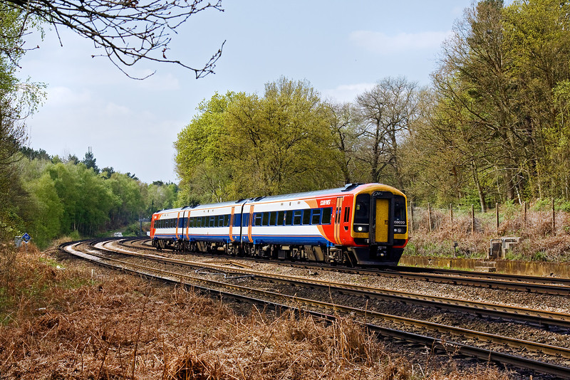 21st Apr 09:  159020 is charged with the 11.45 from Salisbury to Waterloo and is here rounding the curve next to the Basingstoke Canal at Pirbright