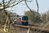1st Apr 09:  At the site of Peasmarsh Junction is 450026 working 1P28 the 09.39 from Haslemere to Waterloo