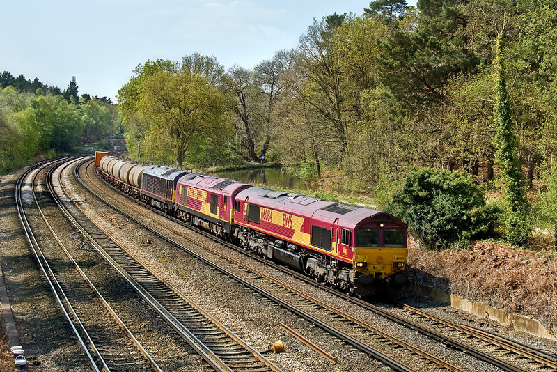 21st Apr 09:  66084 powers 6M44 alongside the Basingstoke Canal at Curzon Bridge in Pirbright.  DIT are 67030 and 67005.