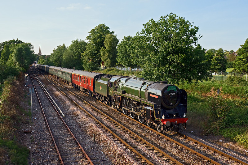 13th Aug 09:  In very soft evening light  70013 'Oliver Cromwell' chugs gently away from Wokingham on the return leg of the Cathedrals Express from Oxford to Victoria.