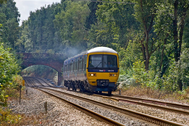 13th Aug 09:  The 10.34 from Redhill to Reading (2V58) climbs away from Sandhurst towards Crowthorne