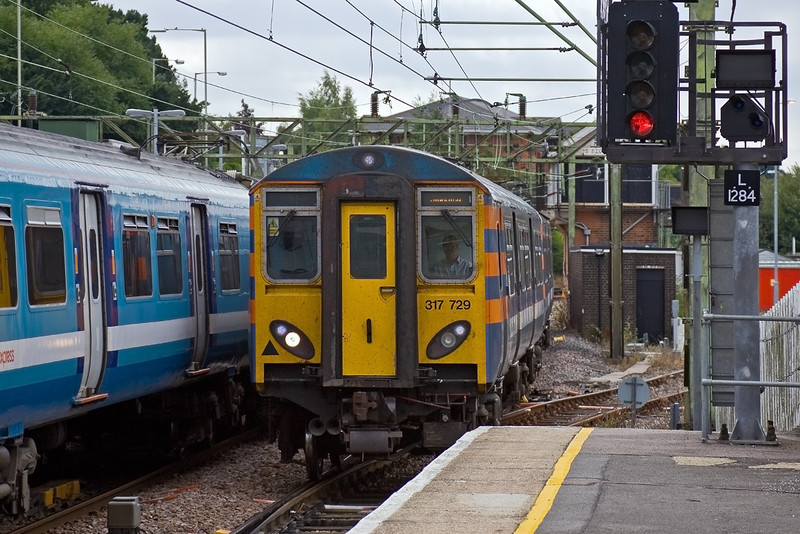 15th Aug 09:  The 10.40 from Liverpool Street to Stanstead Airport enters Bishops Stortford.  1B48 is formed of 317729 .