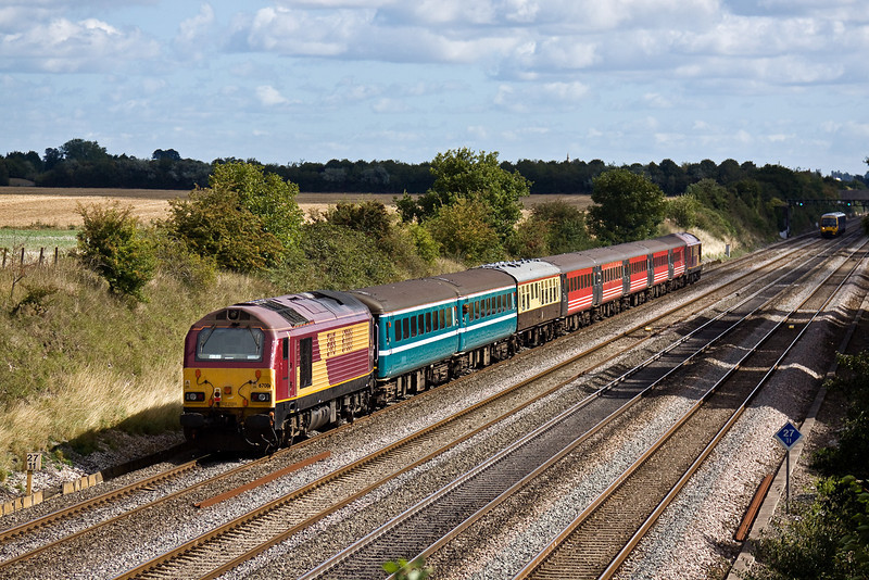 29th Aug 09:   67001 with 67008 leading brings Warrington supporters to Euston for the Rugby League Challenge Cup Final. 5Z69 is seen here running on time up the Relief line through Shottesbrooke between Twyford and Maidehead. They went home very happy!
