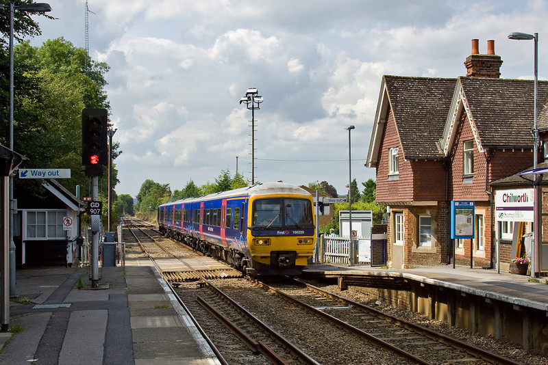 8th Aug 09:  166220 charges through Chilworth while working 1O72 the 12.34 from Reading to Gatwick