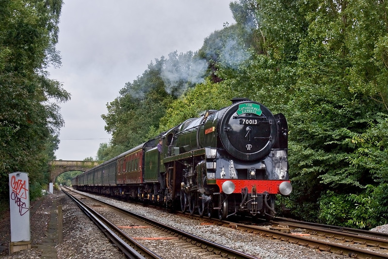 6th Aug 09:  BR Standard 4-6-2, 70013 'Oliver Cromwell' leaves Virginia Water on the 10.12 Cathedrals Express from Waterloo to Bristol Temple Meads