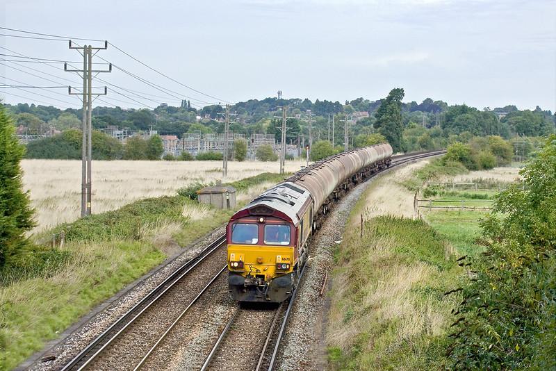 24th Aug 09:  The Fawley to Holybourne tanks run through Badshot Lea behind 66178