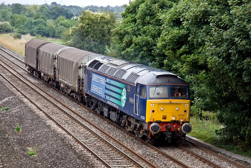 6th Aug 09:  Hired in from DRS 47501 'Craftsman' is standing in for a Colas loco on 6Z48 from Burton to Dollands Moor. Seen here in foul weather at Lower Basildon