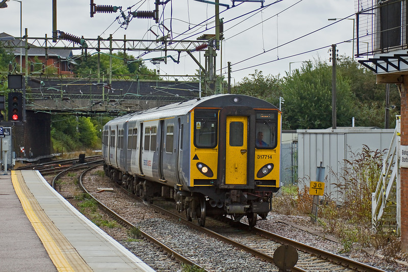 15th Aug 09:  Bound for Stratford from Stanstead 317886 and 2B13 depart from Bishops Stortford