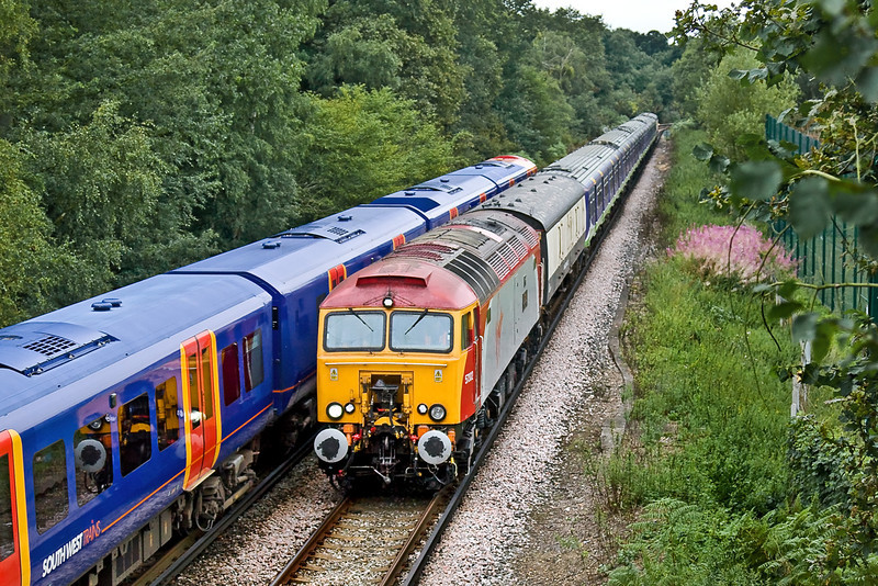 4th Aug 09:  5O21 was a GBRf move of 321429 & 407 from Willesden to Eastleigh with hired in Virgin Thunderbird 57302 being the chosen power. Captured here leaving Virginia Water and with the planned shot snookered by a very slow moving Desiro 450548