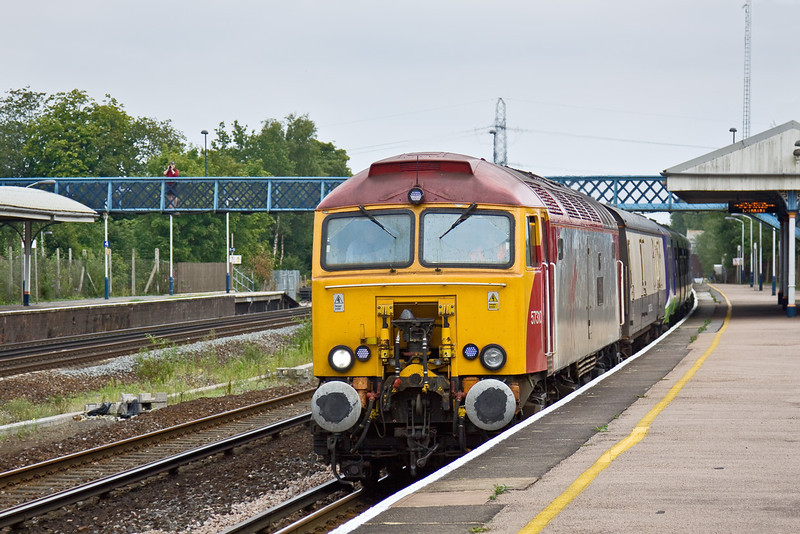 """11th Aug 09:  If Plan A requires full sun and for it to be on the fast a Plan B is essential.  I didn't have one!.   In full dull Virgin Thunderbird 57310 """"Kyrano"""" rolls through Winchfield on the slow line.  Hired by GBRf to transport 321408 and 409, which are Off Lease, from Bletchley to storage at Eastleigh."""